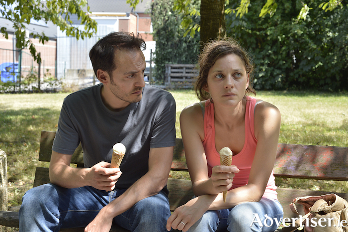 Fabrizio Rongione and Marion Cotillard as Manu and Sandra in Two Days, One Night.
