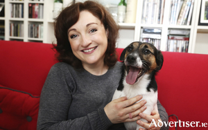 Irish soprano Ailish Tynan with canine friend.