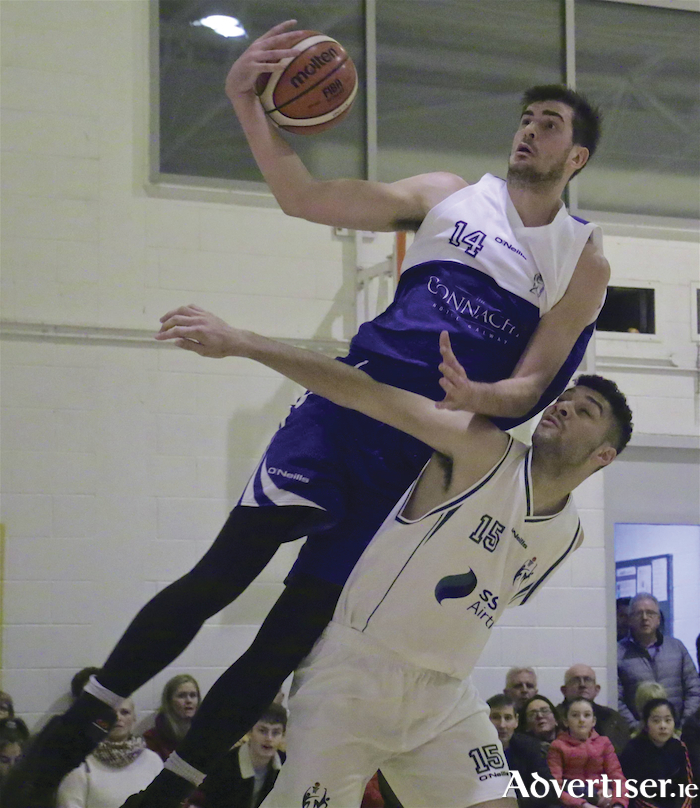 Maree's  Niels Bunschoten prevails over Moycullen's Josh Marvesley in the Basketball Ireland new year derby at Calasanctius College on Saturday night. The home team defeated Moycullen 86-79 to finish three places above their local rivals in the Basketball Ireland Mens Superleague.