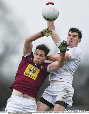 Maryland's Callum McCormack of Westmeath in action against John O'Toole of Kildare during the O'Byrne Cup match at the Downs GAA Club. Photo by Piaras O' Midheach/Sportsfile