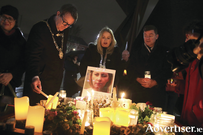 Mayor Niall McNelis lights a candle at the Nollaig na mBan vigil in Eyre Square to remember women affected by the Cervical Check scandal. Photo:- Mike Shaughnessy