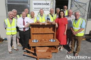 Minister Michael Ring and TD Hildegarde Naughton with member's of the Oranmore Men's Shed.