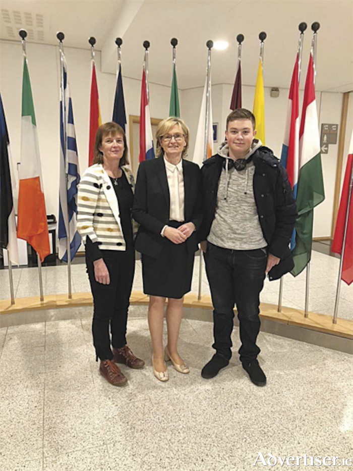 Local MEP, Mairead McGuinness, is pictured with Marie Moran, group leader and Marist College student, Sorin Stoleru, during his visit to the European Parliament in Brussels