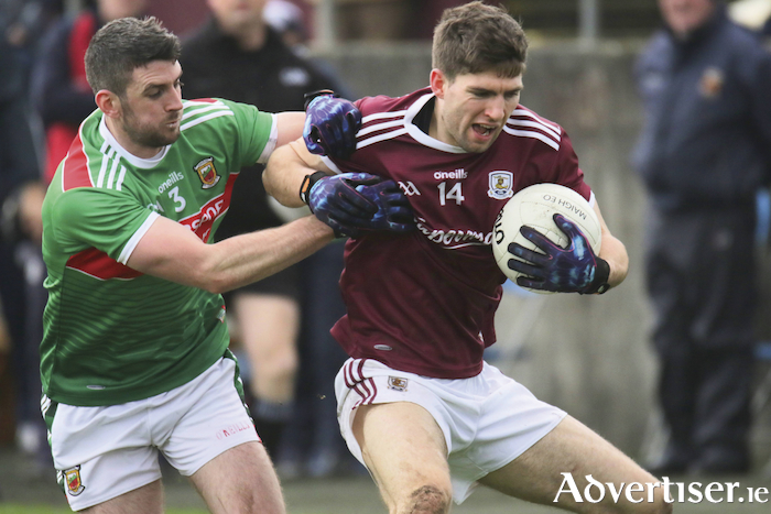 Galway's Michel Boyle and Mayo's Brendan Harrison in action from the Connacht FBD League semi-final at Tuam Stadium, Sunday. Photo:-Mike Shaughnessy
