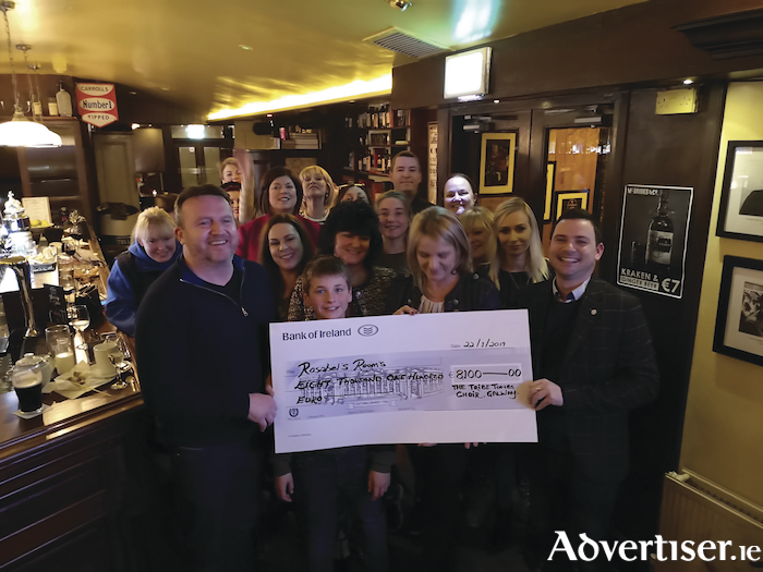 Pictured at the presentation of proceeds from the Winter's Tale charity single which raised €8100 for Rosabel's Rooms were Gary Monroe and Suzanne McLean of Rosabel's Rooms, TribeTones choir director Sean Rowland, and choir members and supporters.