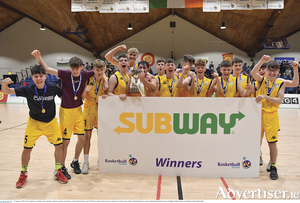 The Colaiste na Coiribe team celebrate with the cup after the Subway All-Ireland Schools Cup U19 B Boys final match between Colaiste na Coiribe and Colaiste Pobail Beanntrai at the National Basketball Arena in Tallaght, Dublin. 						Photo: Brendan Moran/Sportsfile