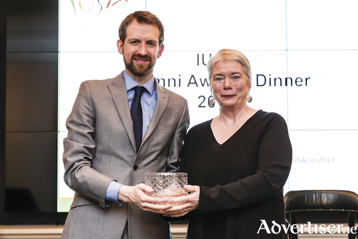 Mary McPartlan, NUI Galway receives her Distinguished Alumni Award from Vincent McCarthy at the Irish United States Alumni Association Awards Ceremony in Dublin. Photo: Sean Curtis (designmaketake.com)