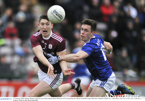 A determined Johnny Heaney  of Galway contests possession with Dara McVeety of Cavan during the Allianz Football League division one  opening match between Galway and Cavan at Pearse Stadium in Galway. 	