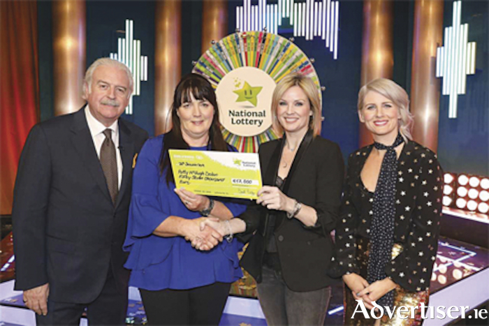 Streamstown native, Patty McHugh Dolan, with her winnings following her appearance on the National Lottery Winning Streak game show