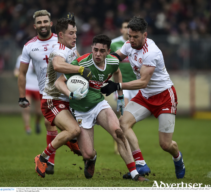 Making his way: Ciaran Tracey tries to break through the Tyrone defence. Photo: Sportsfile