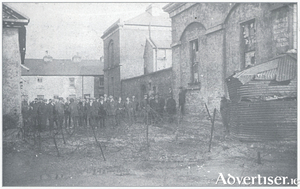 Prisoners exercising between the Town Hall 'prison' and the old Protestant Hall, 1920 - 1921.
