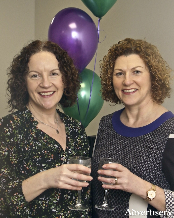 Breda Maughan and Paula Donovan, New Ireland Assurance at the opening of Hennelly Finance new office in Bearna. Photo:-Mike Shaughnessy