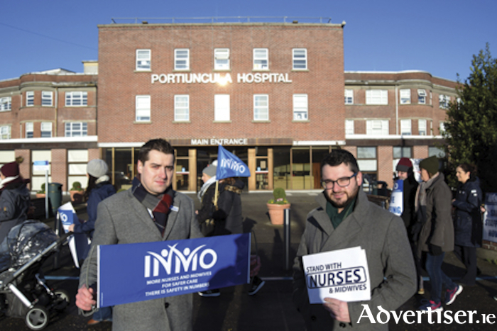 INMO Organiser, Dean Flanagan (left), is pictured with Sinn Fein local election candidate Padraig Hegarty on the Portiuncula Hospital picket line in Ballinasloe