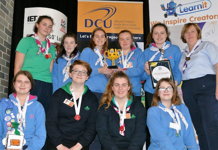 Irish Girl Guides' Team Sparrots pictured with the Lego cup they won in the research category of the first Lego League Leinster finals in Dublin City University, including two Ballina Girl Guides – Ella Douglas (13), is far right in the front row, and Chloe Gaughan, (12), is second left in the back row.