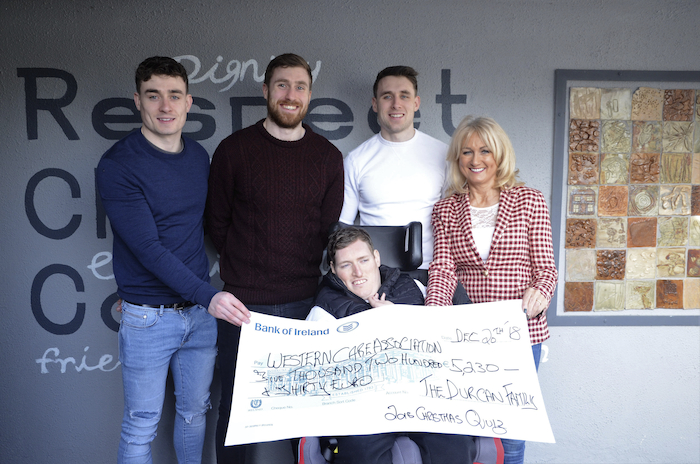 Photographed at the presentation of the proceeds of the Christmas Table Quiz to Western Care's Lower Lakelands Residential and Respite Service, Manulla are James, Mark, Patrick, Garry and Mary Ann Durcan. Photograph: John Moylette Photography