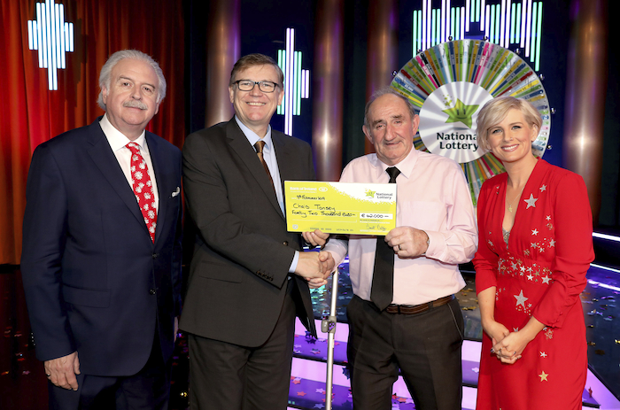 Chris Tansey from Swinford, Co. Mayo has won €42,000 on last Saturday Winning Streak Game Show on RTE. He is pictured with his winners cheque alongside: Marty Whelan (show co-host), Michael Hayes (Head of marketing at the National Lottery) and Sinead Kennedy  (show co-host). The winning ticket was purchased from Dalton Service Station, Ring Road, Castlebar. Photo: MacInnes Photography.