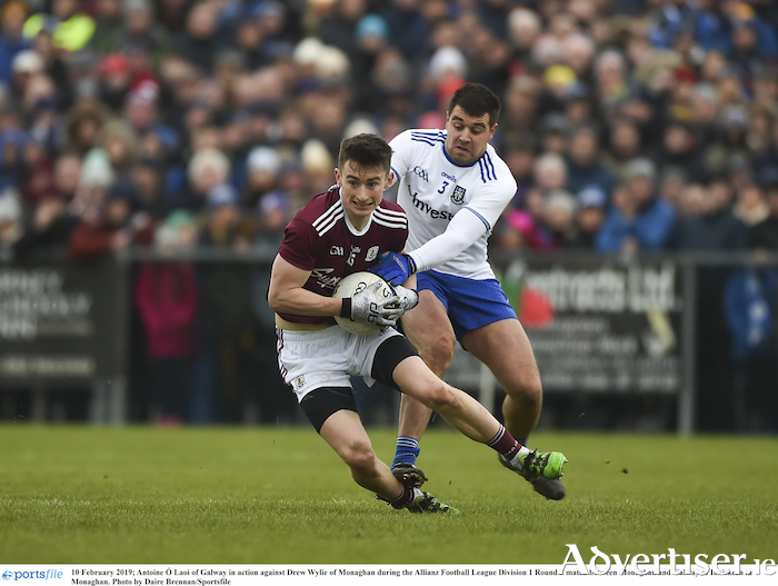 Antoine O Laoi of Galway escapes the attention of Monaghan's Drew Wylie in the Allianz Football League division one round three match at Inniskeen in Monaghan.