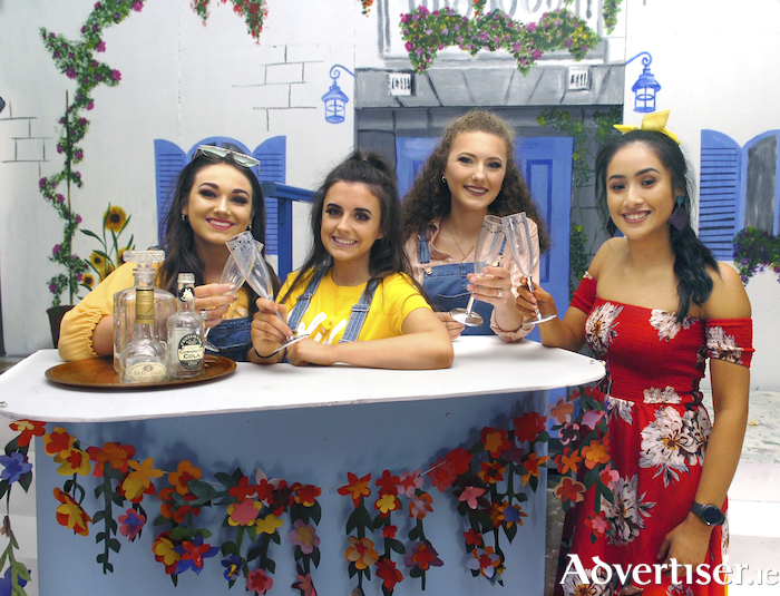 Anita (Mitchella Lacuesta), Elena (Robyn Allen), Maria (Emma Bailey) and Laura (Ciara Mullarkey) have a drink in Laura's Spanish Taverna. Photo: Henry Wills.