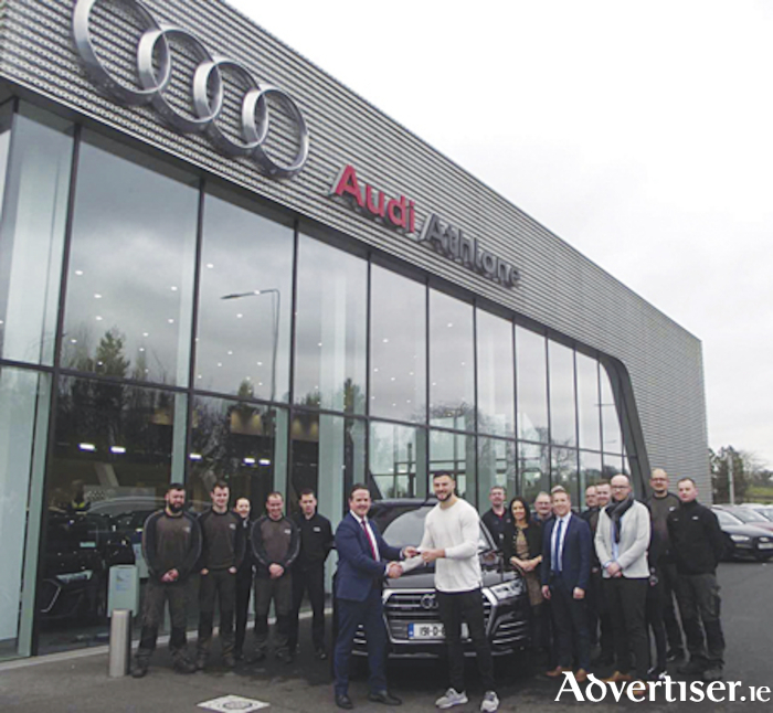 Audi Athlone brand ambassador Robbie Henshaw collects his new Q5 from John Flanagan, Brand Manager at Audi Athlone, along with Audi Athlone staff.