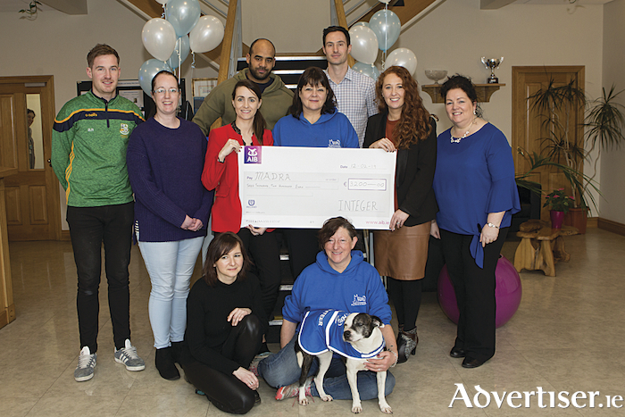 Employees from Integer Sports and Social Club presenting a cheque to Madra, their 2018 chosen charity of the year.  The proceeds raised were from various fundraising events throughout the year with a matching donation from the business.    