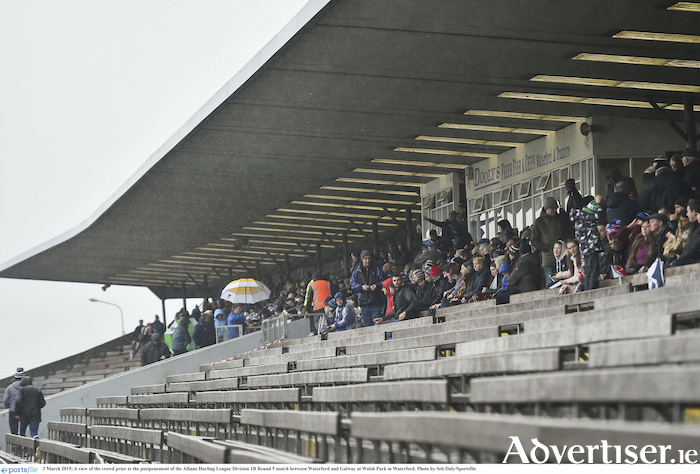 Waiting in the rain: A view of the crowd prior to the postponement of the Allianz Hurling League division 1B match between Waterford and Galway at Walsh Park in Waterford. The game will be replayed on Sunday at 2pm.