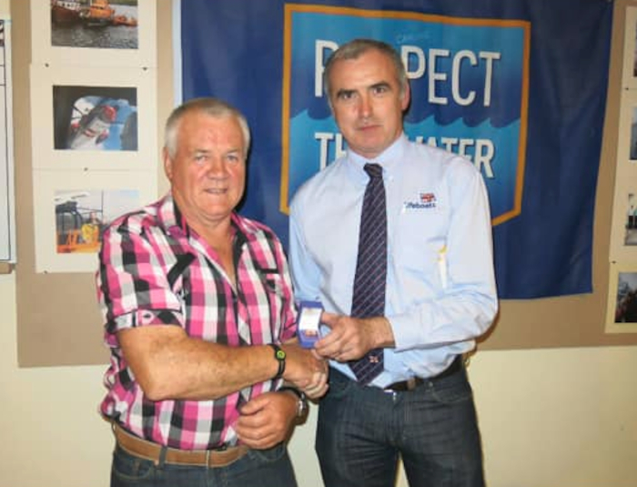 Mattie Stafford pictured with Declan Dixon from the RNLI when he received his 20 years Long Service Medal in recognition of his time spent on the lifeboat crew.