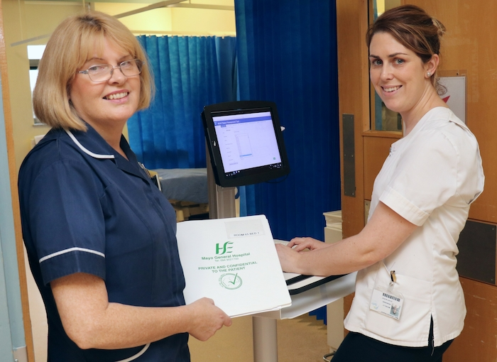 Staff nurses Mary Neary and Michelle Heneghan using a 'point of care' computer on the C Ward at Mayo University Hospital.