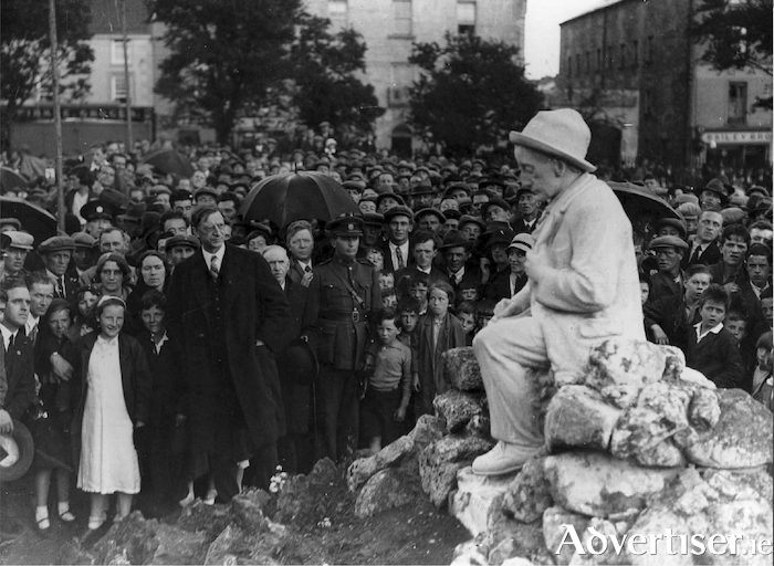 President Éamon de Valera and a large crowd at the unveiling of the Pádraic Ó Conaire's statue at Eyre Square June 9 1935, nineteen years after the Easter Rising. He had admired his class mate's wicked sense of humour and his romantic observations of rural people, written in a modern Irish style.  The ceremony was conducted as Gaeilge, and nationally broadcast on radio. The statue became Galway's best-loved and the most photographed landmark.   .