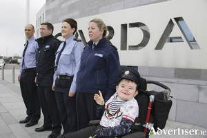 Sean Walsh McDonagh from Ros a' Mhíl,  lives with the condition Hemimegalencephaly, a dream of eight-year-old was fulfilled on Tuesday when he was made a honorary Garda at the regional Garda HQ, Murrough. Pictured with Garda Sean were Brian O'Donnell, Alan Keane, Fiona White and Linda Walsh. Photo:-Mike Shaughnessy
