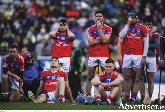 Dejected St Thomas players can only watch the celebrations afer Ballyhale Shamrocks win the AIB GAA Hurling All-Ireland Senior Club Championship final at Croke Park in Dublin.