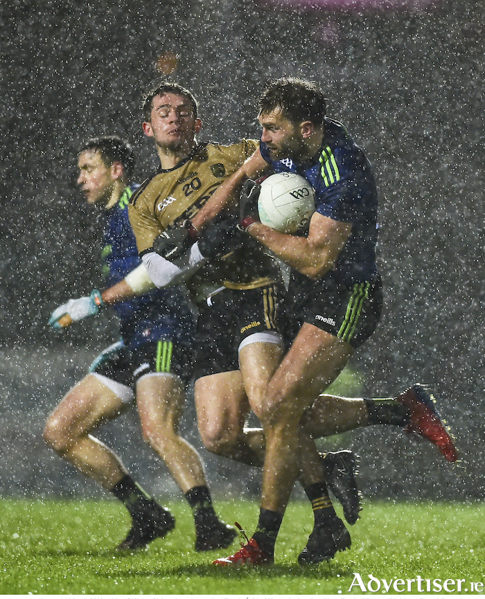Back in blue: Aidan O'Shea drives past the challenge of Thomas O'Se in the rain in Tralee last weekend. Photo: Sportsfile