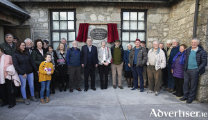 Many of the people active in Gluaiseacht Chearta Sibhialta na Gaeltachta stand at the commemorative plaque 50 years on. Pic:- Seán Ó Mainnín