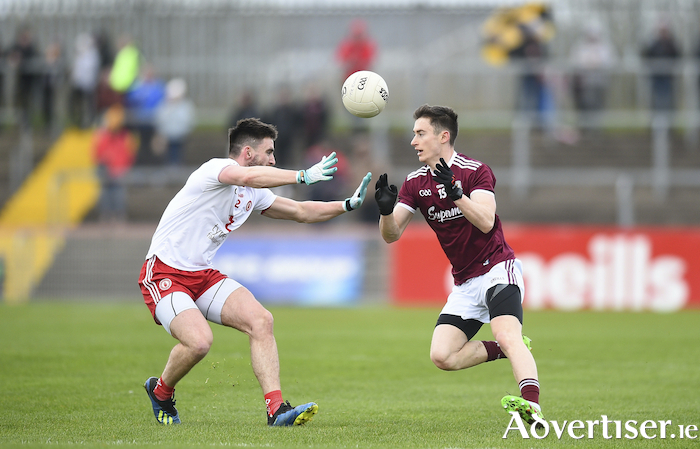 Galway'ws Antaine O'Laoi (right), in action against Padraig Hampsey of Tyrone,  has added to Kevin Walsh's options in the full forward line. 