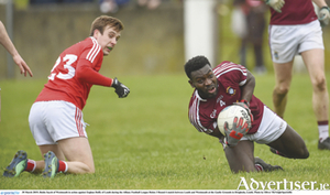 Rosemount GAA club player, Boidu Sayeh, retrieves possession during the Allianz Football League draw game with Louth at the Gaelic Grounds in Drogheda.  The result ensured promotion for Westmeath and a place in the divisional final against Laois on Saturday. Photo by Oliver McVeigh/Sportsfile.