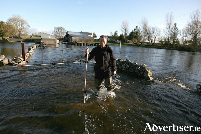 Farmer Mickey Morgan from Skehana, pictured in 2014 stranded by floods when his farm was completely under flood water. Picture: Hany Marzouk.