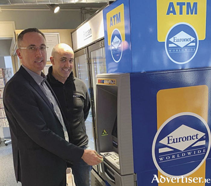 Cllr. Aengus O'Rourke with Patrick Walsh testing the new ATM which has been installed in Walsh's Centra convenience store on Athlone's west side.