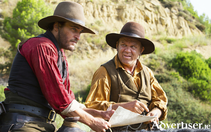 John C Reilly and Joaquin Phoenix in The Sisters Brothers.