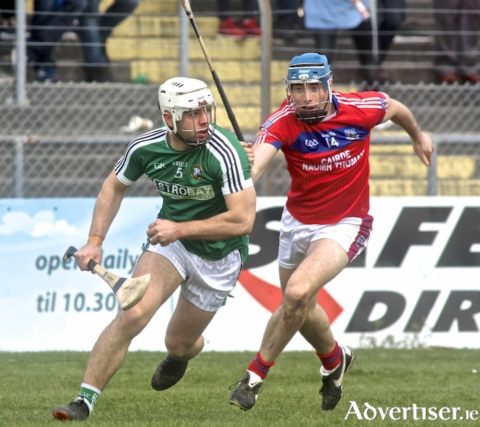 St Thomas' Conor Cooney chases Mark Hughes of Liam Mellows in action from the opening game of the Salthill Hotel Senior Hurling Championship, Kenny Park, Sunday. Photo:-Mike Shaughnessy