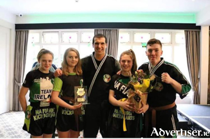 Martin Ward of Na Fianna kickboxing and fitness centre, pictured with group members, as they were presented with the accolade of overall winner for their entry in this year's St. Patrick's Day parade.