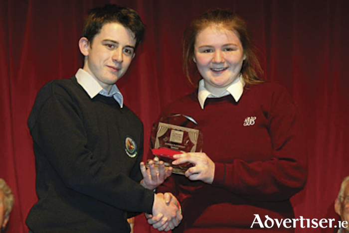 Emma Flaherty, Sacred Heart Secondary School, Tullamore, winner of the award in 2018, receives her accolade from the previous prize recipient, John Croghan