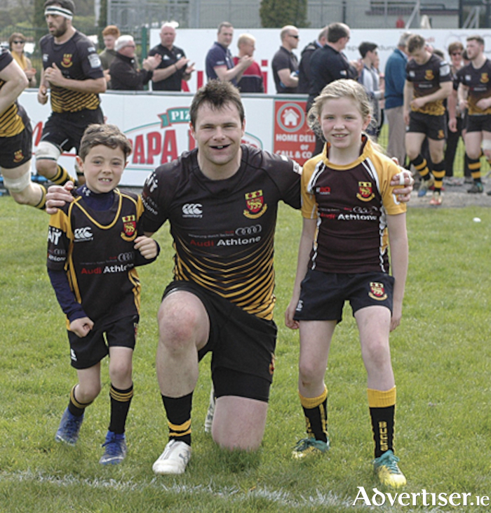 Buccaneers captain, Shane Layden, pictured with mascots, Joe O'Sullivan and Sally Fleming, prior to the play-off loss to Queen's University