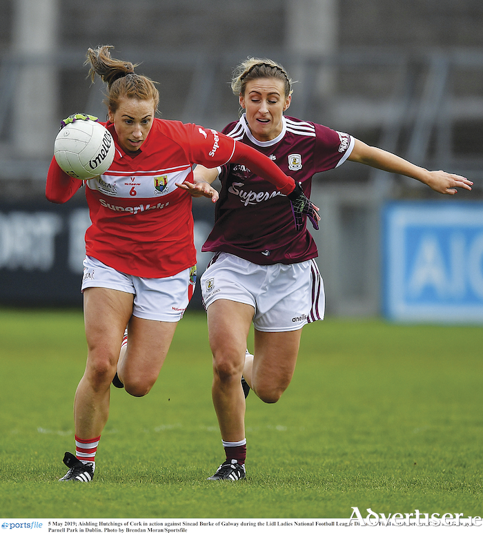 Aishling Hutchings of Cork is chased down by Sinead Burke of Galway during the Lidl Ladies National Football League division one final at Parnell Park in Dublin. 	Photo by Brendan Moran/Sportsfile
