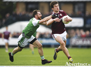 Galway's Michael Daly of Galway is chased by Conor O'Neill of London during the Connacht GAA Football Senior Championship Quarter-Final match between London and Galway at McGovern Park in Ruislip, London, England. 
