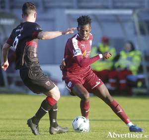 Galway united's Wilson Waweru and Wexford's Thomas Croke  in action from the SSE Airtricity League game at Eamonn Decay Park, Friday. Photo:-Mike Shaughnessy