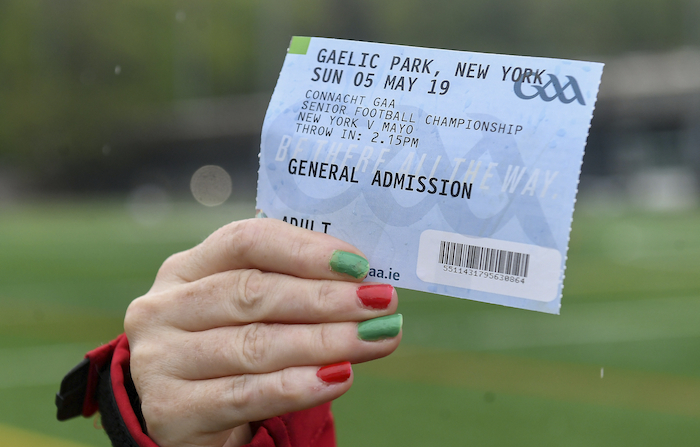 They came they saw and they had a good time: A Mayo supporter holds aloft a ticket for last weekends game in Gaelic Park. Photo: Sportsfile.