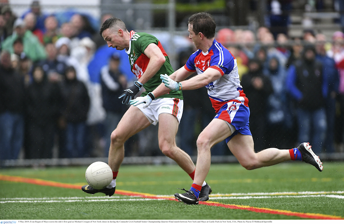 Back of the net: Evan Regan hits Mayo's goal against New York despite the best efforts of Michael Creegan in Gaelic Park. Photo: Sportsfile.