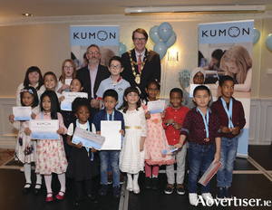 Maths awards, foundation levels at the Kumon Awards Ceremony: Roisin Lavelle, Emiko Hibionada, Hana Rosie Nasri, Sofia Paskauskaite, Maire Connolly, Eunice Aloro, Unique Adetona, James Coyne (CEO Westside Resource Centre), Arron Langan, Denver John Aliganga, Sara Abdalla, Mayor of Galway Niall McNelis, Kowshikaa Raj, Hashir Salum,Nakhla Abdulkarim, MJ Tadle, and Shiloh Mihes. Photo: Murtography.