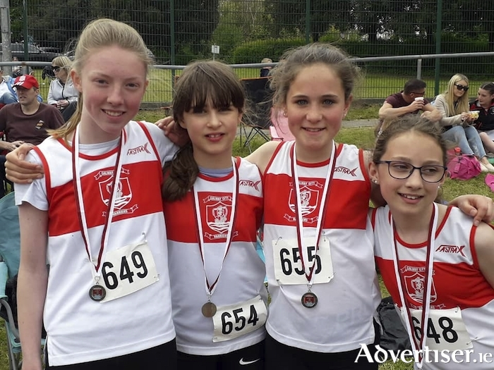 GCH relay athletes,  Tara Keane, Caitlin Podmore, Thea Power, and Eireann Greene.
