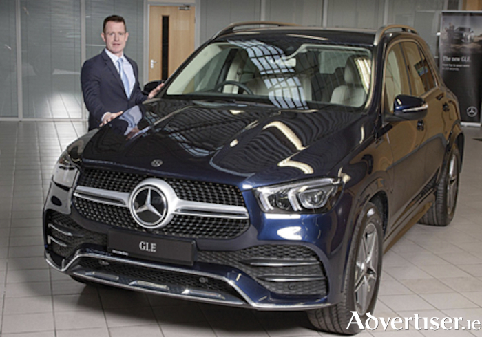 Ian Moore of Michael Moore Car Sales is pictured with the new Mercedes-Benz GLE model