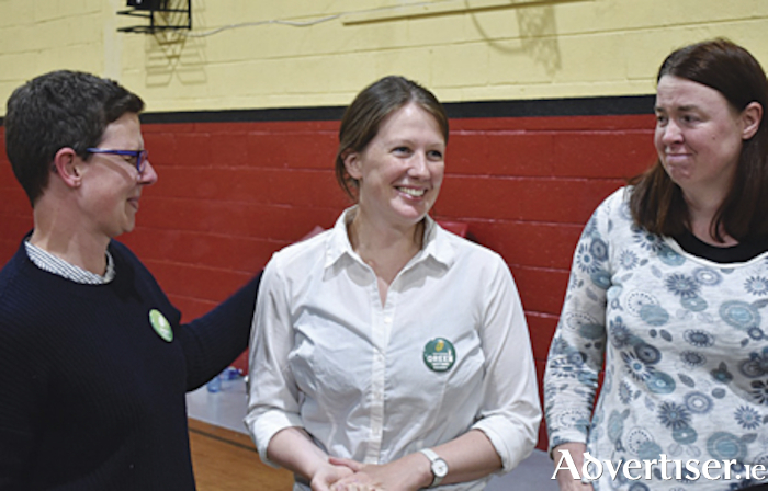 A myriad of contrasting emotions were to the fore during the local election count in Moate Community Hall, in particular for first time Green Party candidate, Louise Heavin, who was elected to serve the Athlone electoral area at 11pm on Sunday night following the 11th count of votes. Louise is the sole female Councillor in the electoral area and is pictured in jubilant mode after her election was announced with her sister Teresa Heavin and campaign manager Meabh Cody.